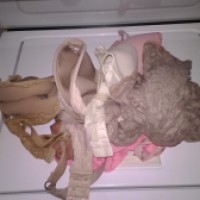 Frilly girl clothes mangled by manhandling-washer